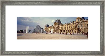 Tourists Near A Pyramid, Louvre Framed Print by Panoramic Images