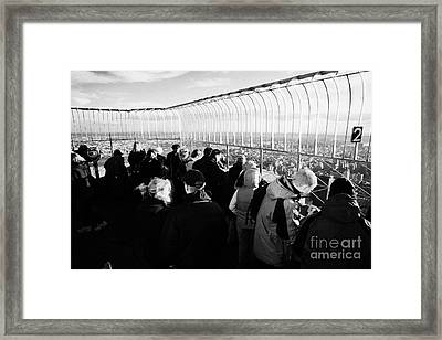 Tourists On Observation Deck Of The Empire State Building New York City Usa Framed Print by Joe Fox
