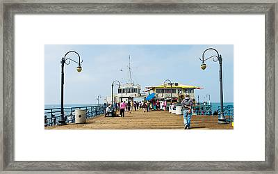 Tourists On Santa Monica Pier, Santa Framed Print by Panoramic Images