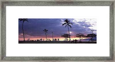 Tourists On The Beach, Honolulu, Oahu Framed Print by Panoramic Images