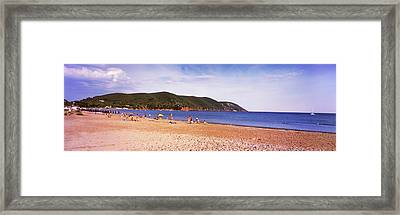 Tourists On The Beach, Island Of Elba Framed Print by Panoramic Images