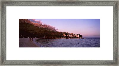 Tourists On The Beach, Makarska Framed Print by Panoramic Images