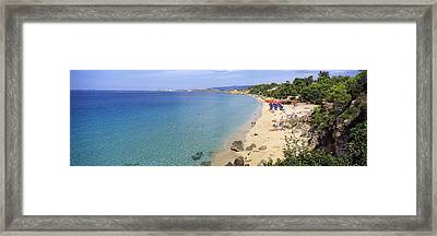 Tourists On The Beach, Platis Gialos Framed Print