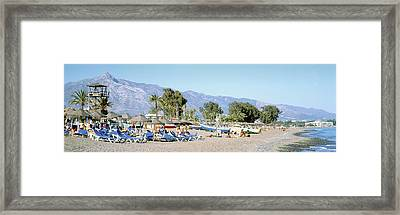 Tourists On The Beach, San Pedro, Costa Framed Print by Panoramic Images