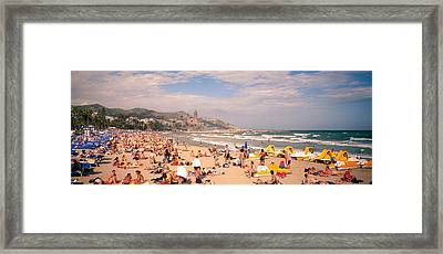 Tourists On The Beach, Sitges, Spain Framed Print by Panoramic Images