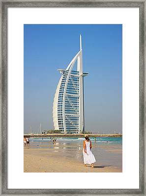 Tourists On The Beach With Burj Al Arab Framed Print