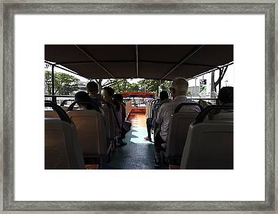 Tourists On The Sight-seeing Bus Run By The Hippo Company In Singapore Framed Print by Ashish Agarwal