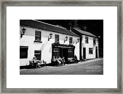 Tourists Outside Fitzgeralds Pub In The Village Of Avoca From The Tv Series Ballykissangel Framed Print by Joe Fox