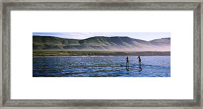 Tourists Paddleboarding In The Pacific Framed Print by Panoramic Images