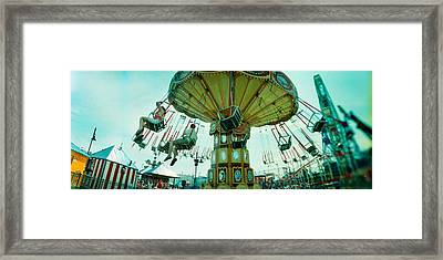 Tourists Riding On An Amusement Park Framed Print by Panoramic Images