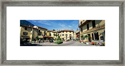 Tourists Sitting At An Outdoor Cafe Framed Print by Panoramic Images
