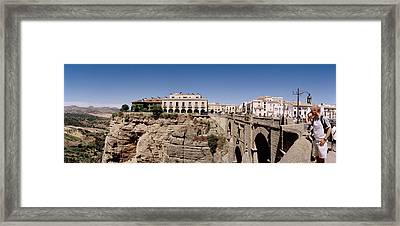 Tourists Standing On A Bridge, Puente Framed Print by Panoramic Images