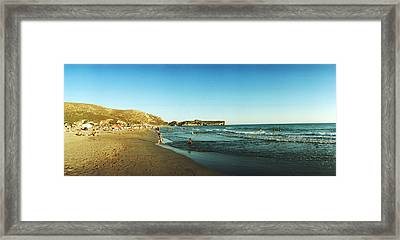 Tourists Swimming In The Mediterranean Framed Print by Panoramic Images