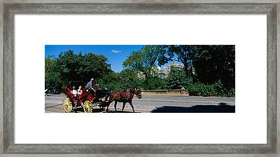 Tourists Traveling In A Horse Cart Framed Print by Panoramic Images