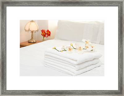 Towels On Bed Framed Print by Amanda Elwell