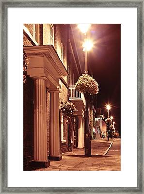 Town At Night Framed Print by Tom Gowanlock