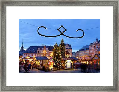 Town Lit Up At Night On Christmas Framed Print by Panoramic Images