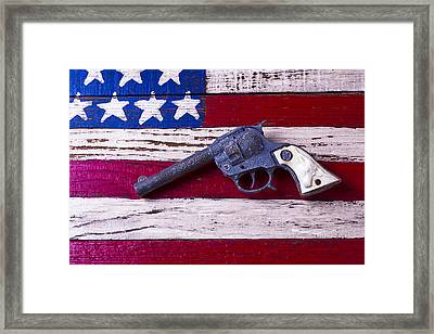 Toy Gun On Wooden Flag Framed Print by Garry Gay