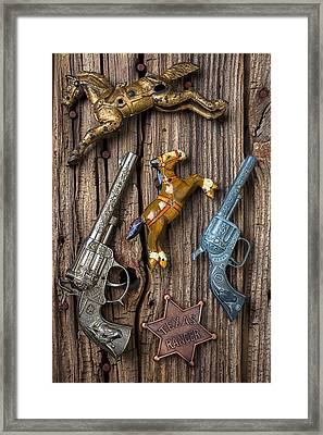Toy Guns And Horses Framed Print by Garry Gay