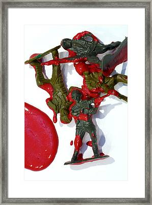 Toy Soldiers In A Pool Of Blood Framed Print
