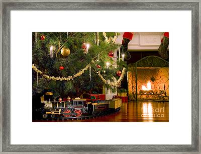 Toy Train Under The Christmas Tree Framed Print by Diane Diederich