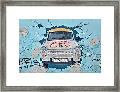 Trabant On The Berlin Wall Framed Print by Gynt