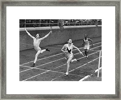 Track Runners At Finish Line Framed Print by Underwood Archives