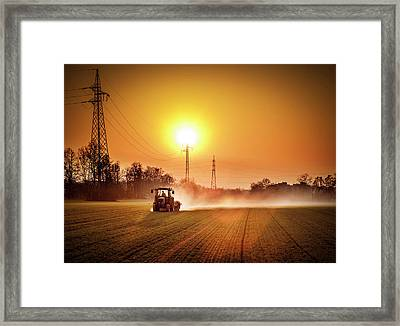 Tractor In A Field At Sunset Framed Print by Rinocdz