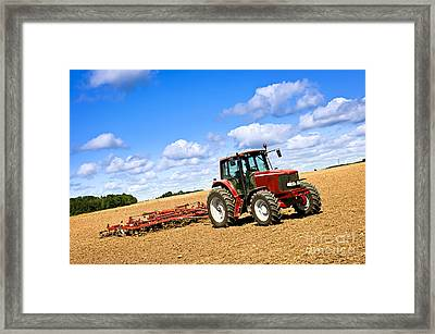 Tractor In Plowed Farm Field Framed Print
