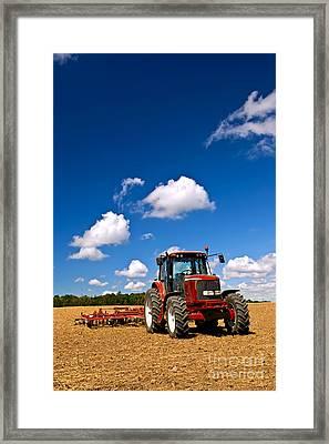 Tractor In Plowed Field Framed Print by Elena Elisseeva