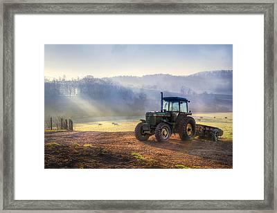 Tractor In The Fog Framed Print by Debra and Dave Vanderlaan