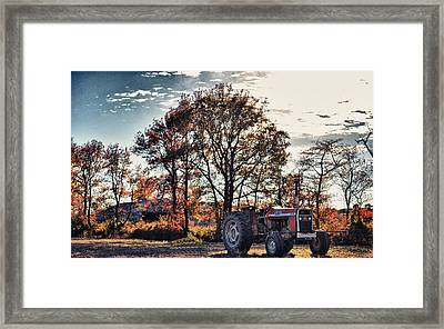 Tractor Out Of The Barn Framed Print by Kelly Reber