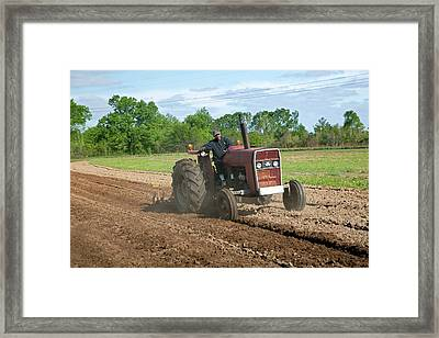 Tractor Ploughing A Field Framed Print by Jim West