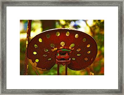 Tractor Seat Framed Print