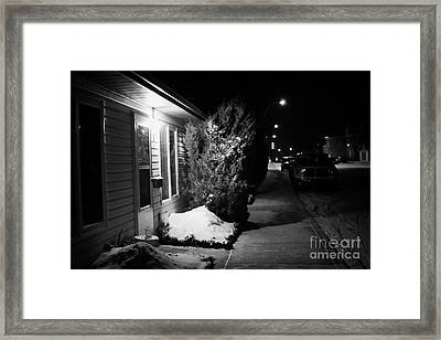 Traditional House With Porch Light Outside The Door And Snow Cleared Pavements At Night Delisle Sask Framed Print by Joe Fox
