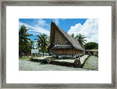 Traditional House With Stone Money Framed Print