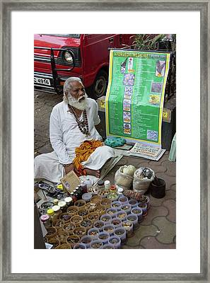 Traditional Indian Medicine Seller Framed Print by Mark Williamson