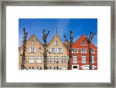 Traditional Old Belgium House Facades In Bruges Framed Print by Kiril Stanchev
