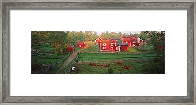 Traditional Red Farm Houses And Barns Framed Print by Panoramic Images