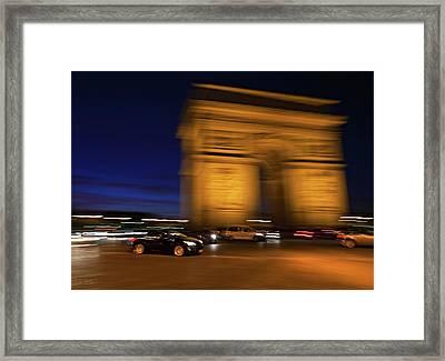 Traffic At The Arc De Triomphe Framed Print