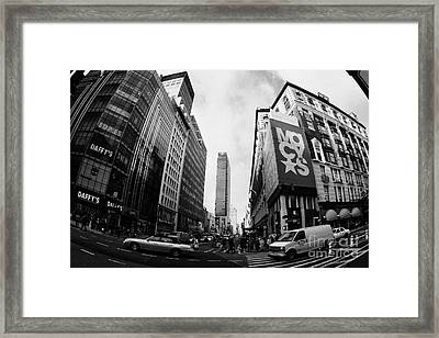 traffic crossing intersection outside Macys at Broadway and 34th Street Herald Square new york usa Framed Print by Joe Fox
