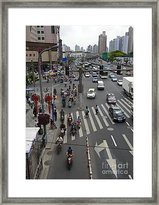Traffic In Shanghai Framed Print by John Shaw