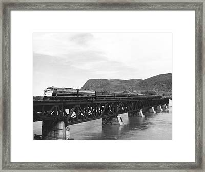 Train Crossing A Trestle Framed Print by Underwood Archives