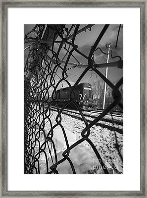 Train Through The Chain Link Fence Framed Print by Edward Fielding