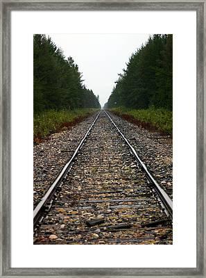 Train Track Vanishing Framed Print by Kevin Snider