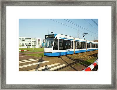 Tram In Ijburg Framed Print by Ashley Cooper