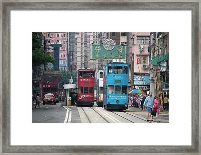 Trams In Hong Kong Framed Print by Tony Camacho