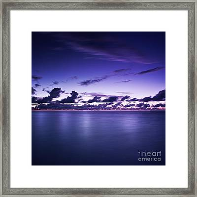Tranquil Ocean At Night Against Moody Framed Print by Evgeny Kuklev