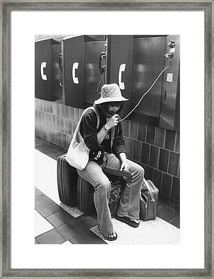 Traveler Talks On Pay Phone Framed Print by Underwood Archives