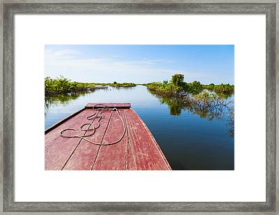 Traveling Through Tonle Sap Lake Framed Print